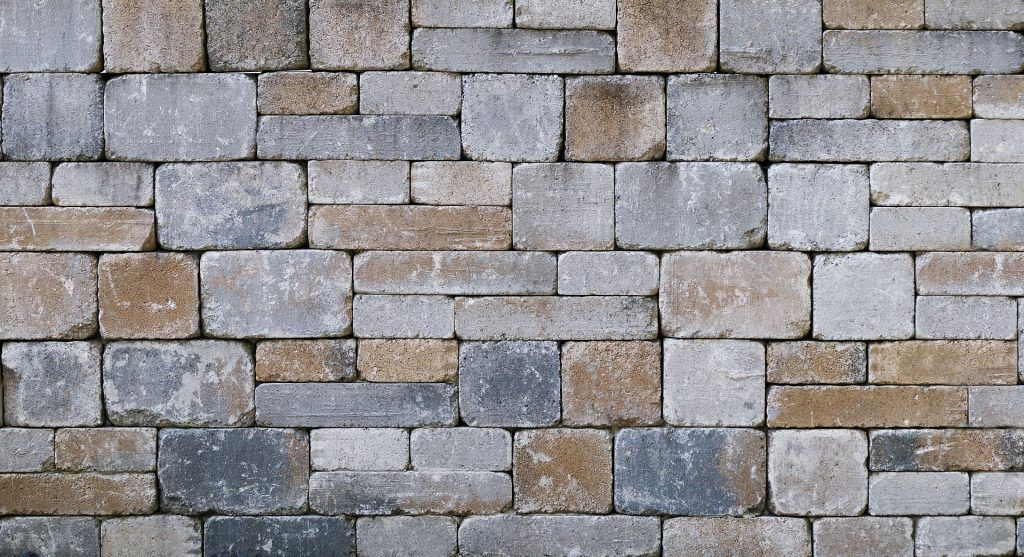 Natural stone wall interlocking pattern.