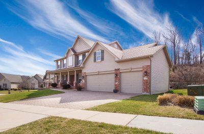 Beautiful two story home with intricate brick and stone interlocking driveway design