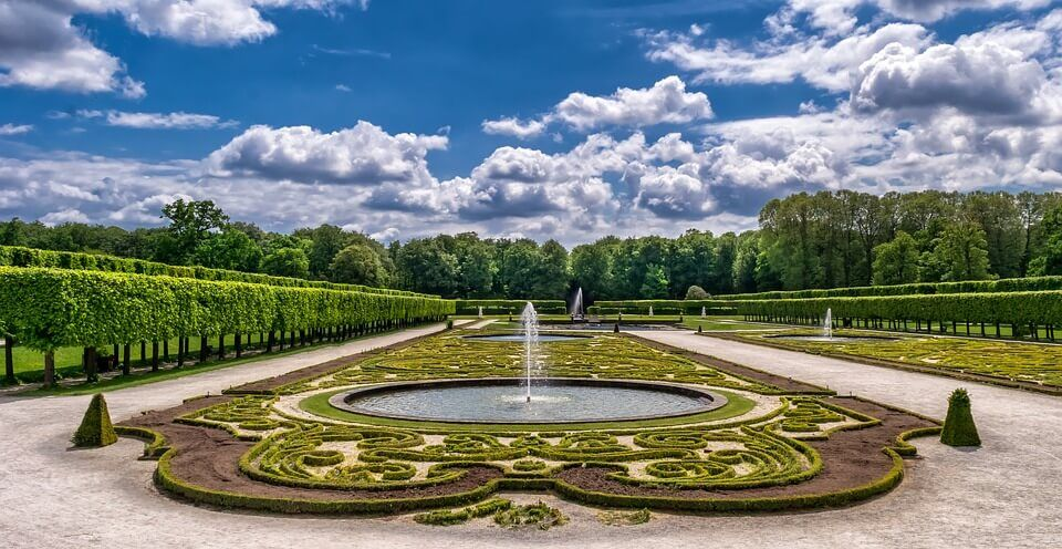 A full view of a large, classic French garden.