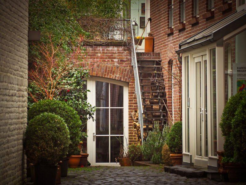 Shot of urban backyard with lots of greenery and interlocking stone