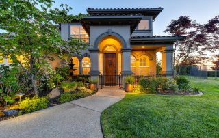 beautiful home with stunning landscaping complimenting the front entry