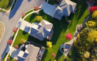 Aerial view of suburban street with homes